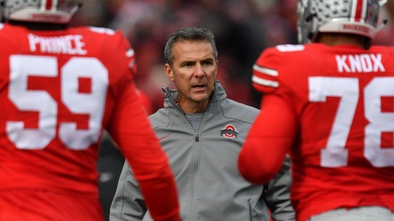 Suspended Ohio State coach Urban Meyer apologizes two days after controversial news conference