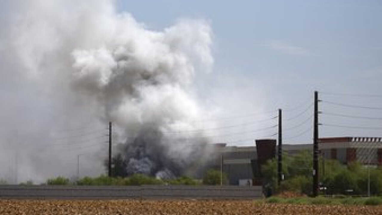 A fire involving hazardous materials burning in a truck trailer parked outside an Amazon warehouse snarled traffic in part of Phoenix on Thursday. Photo/AP.