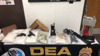 Drugs, guns and money seized during Lansing-area drug trafficking arrests