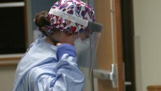 Nurses Putting On PPE.jpg