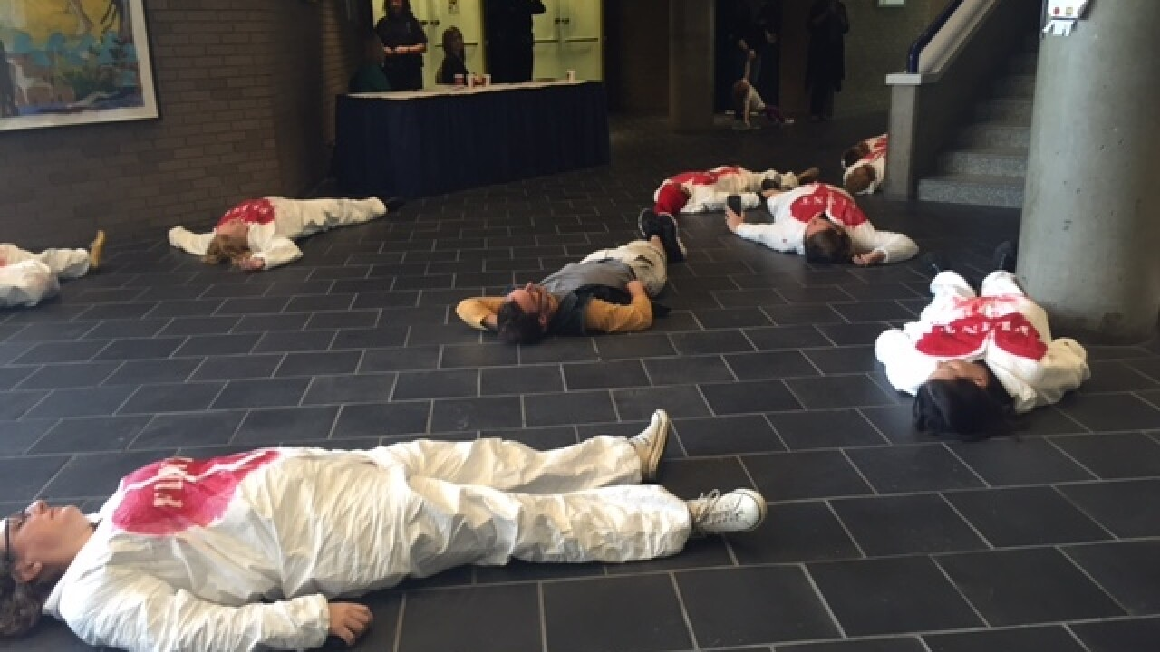"""Flint residents stage """"die-in"""" outside meeting"""