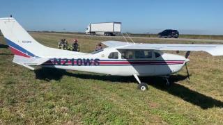small plane lands on median of I-75