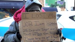 HomelessSignMan.PNG