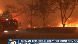 Woman accused in Holy Fire-related scam
