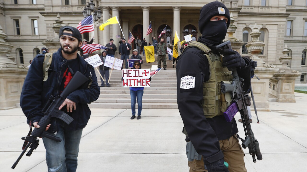 Michigan governor extends state of emergency as armed protesters call for state to reopen