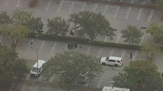 aerial view of car where man found shot in parking lot of Sam's Club in West Palm Beach