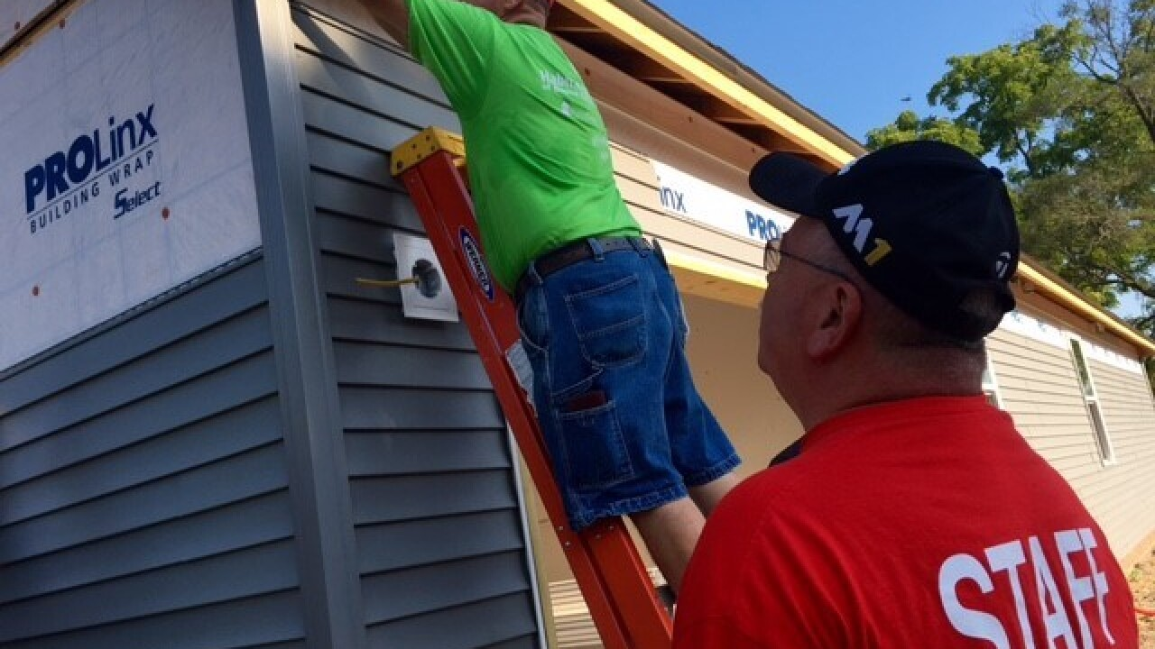 PHOTOS: Police build Habitat for Humanity home