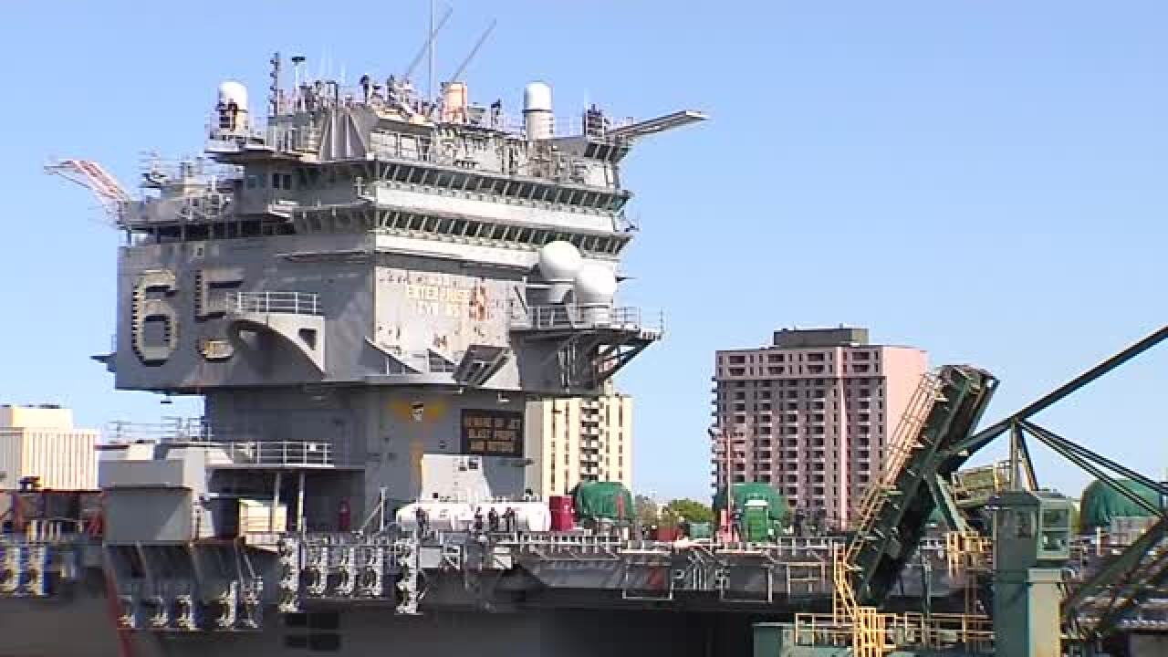 The USS Enterprise moves to her original dry dock as decommissioningcontinues
