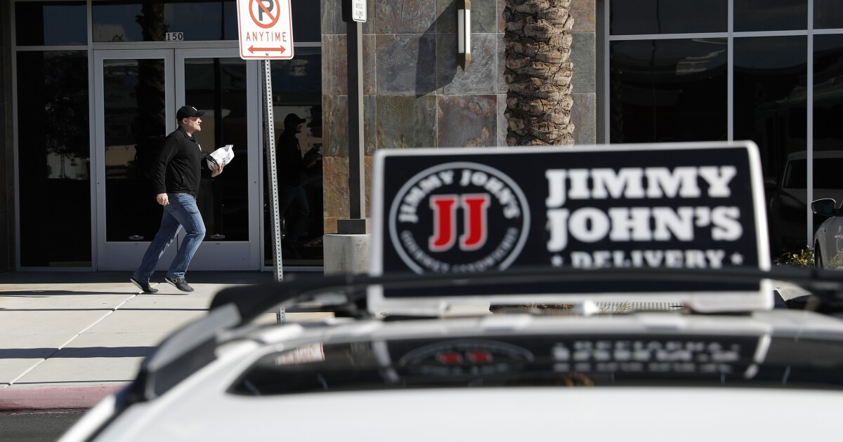 A Jimmy John's sign in front of a building