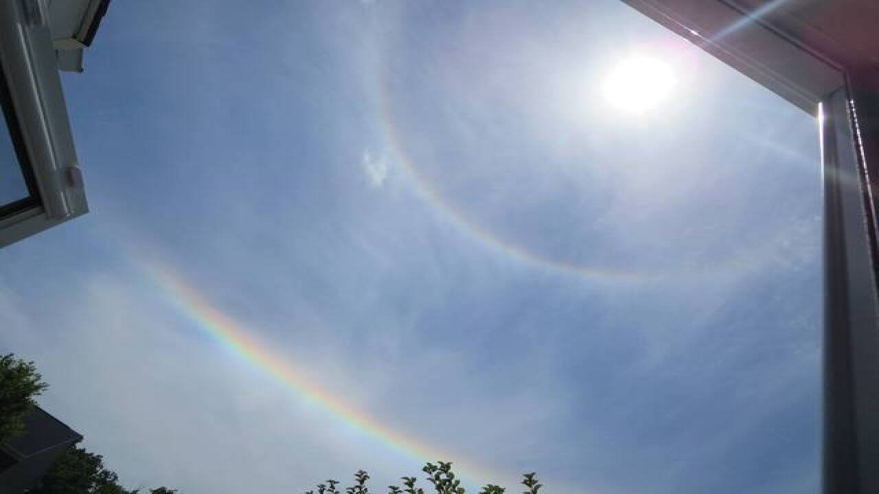 Upside-down rainbows below the sun?