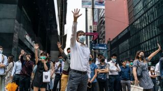 Student protesters prepare to face off with riot police in Hong Kong as tensions reach new heights