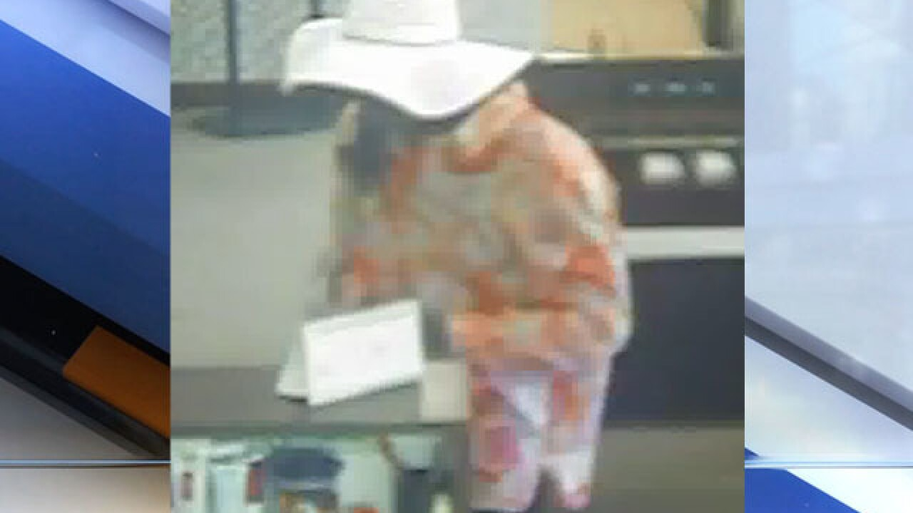 Man who dressed as woman and robbed bank caught