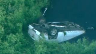 Driver ID'd after truck flips in Belle Glade canal