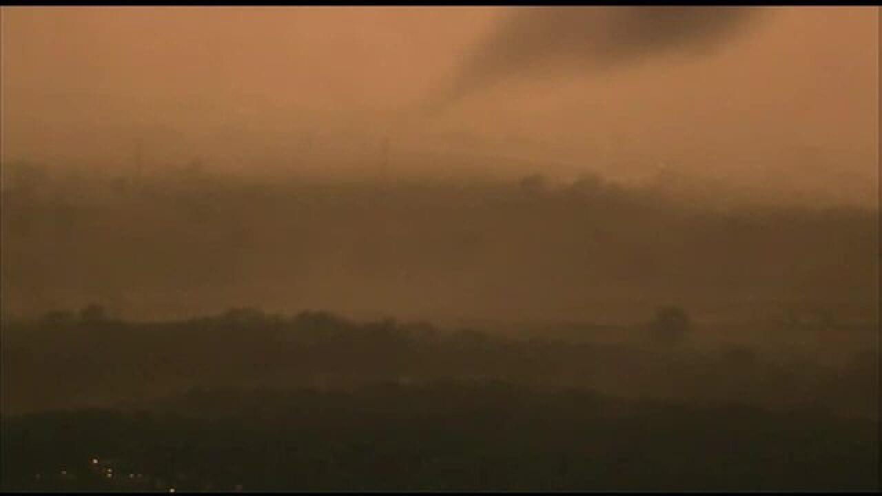 PHOTOS: Tornado forms, touches down