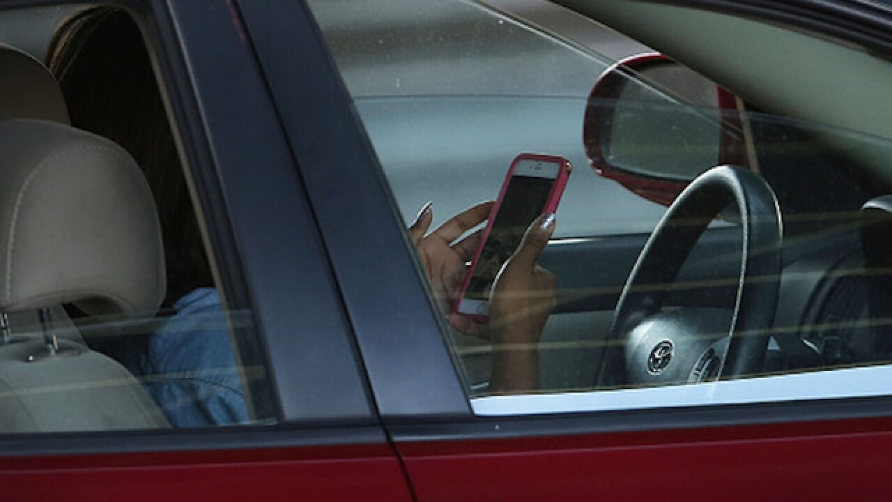 Even parents driving with their kids in the car can't stop texting