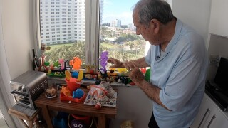 Boca Raton resident Tom Madden has created a Pandemic Playground from trash he's collected at the beach.jpg