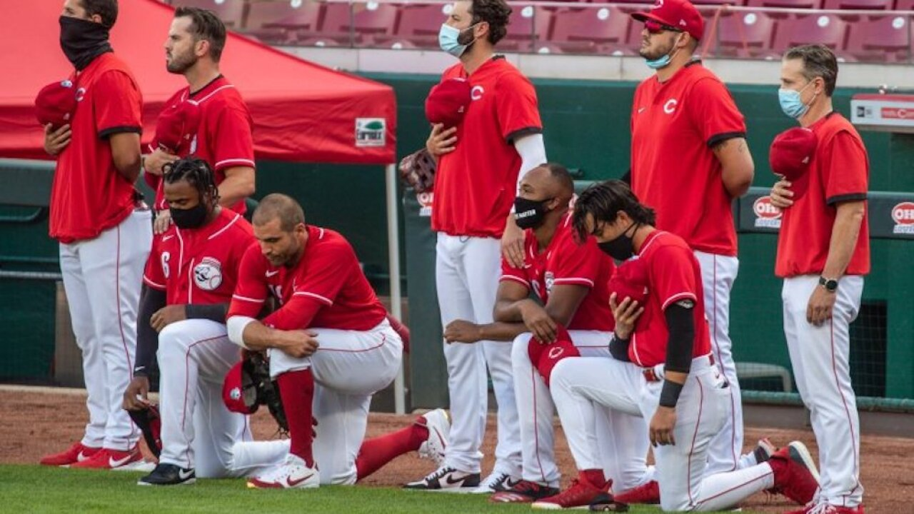 4 Reds players, including star first baseman Joey Votto, kneel during national anthem
