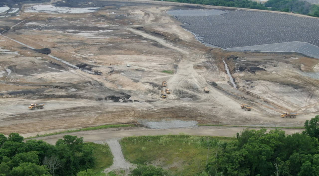 Truckloads of coal ash is being moved to the landfill at Ghent Generating Station