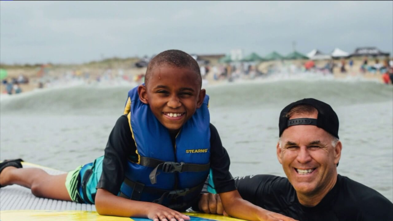 Surfers take children with special needs surfing in Virginia Beach fortherapy