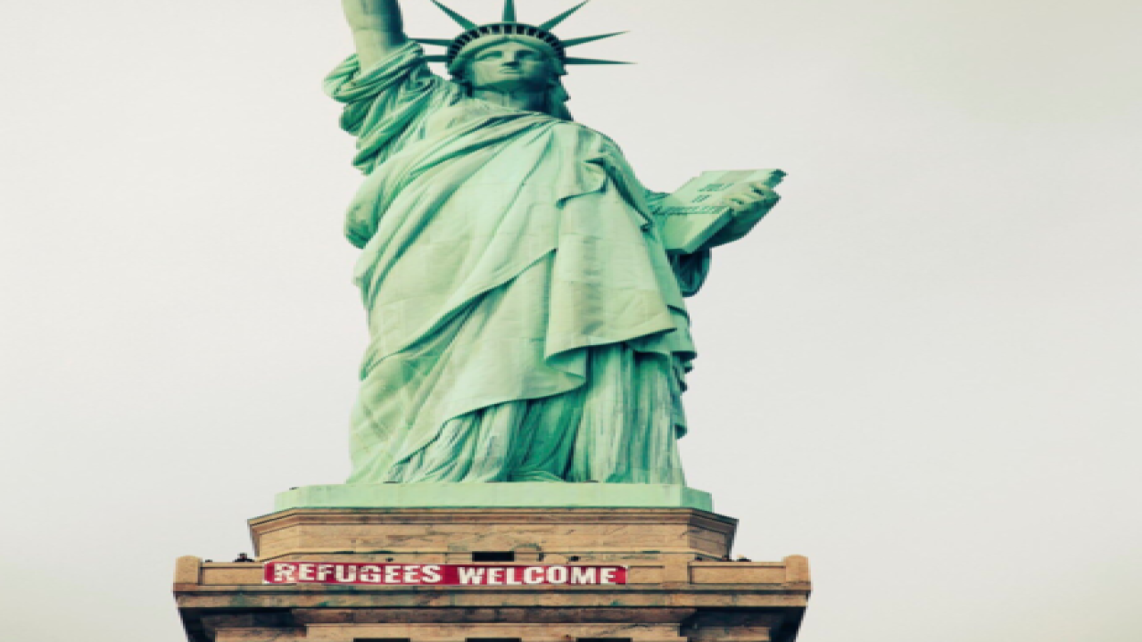 They Were Tearing Down Liberty >> Refugees Welcome Banner Illegally Placed On Statue Of Liberty