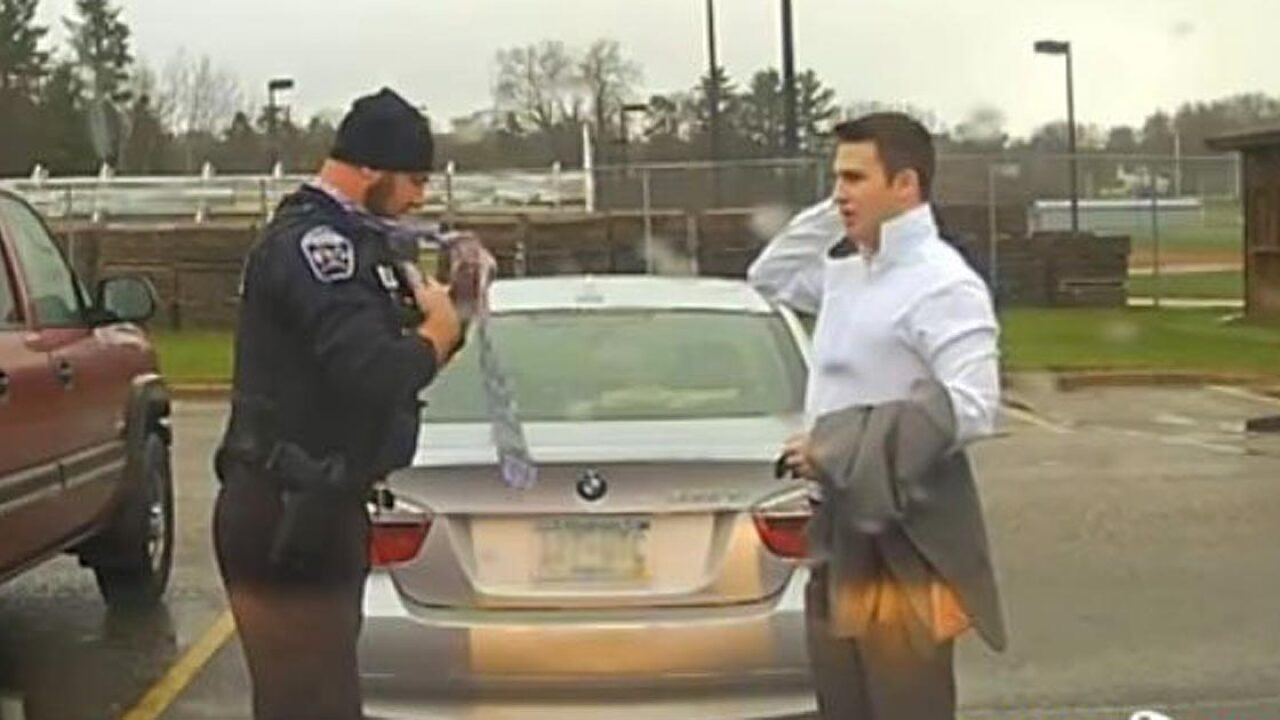 Police officer pulls over student for speeding, then helps him tie his tie