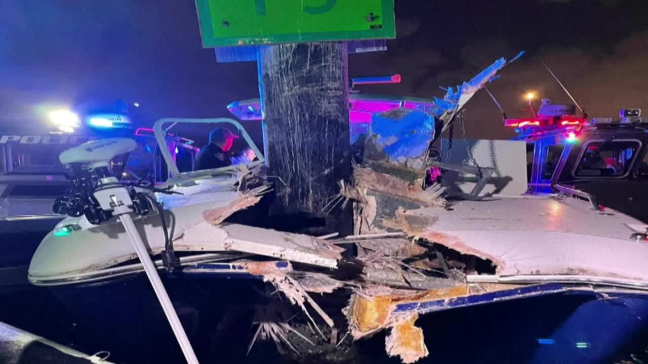 Two people were hospitalized after a boat crash in Miami Friday night.