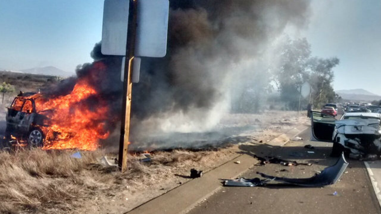 Crash, vehicle fire on SR-163 blocks lanes
