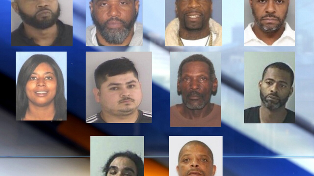 Officials arrest 11 people charged with shipping drugs from