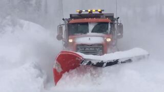 Watch plow clear feet of snow from Little CottonwoodCanyon