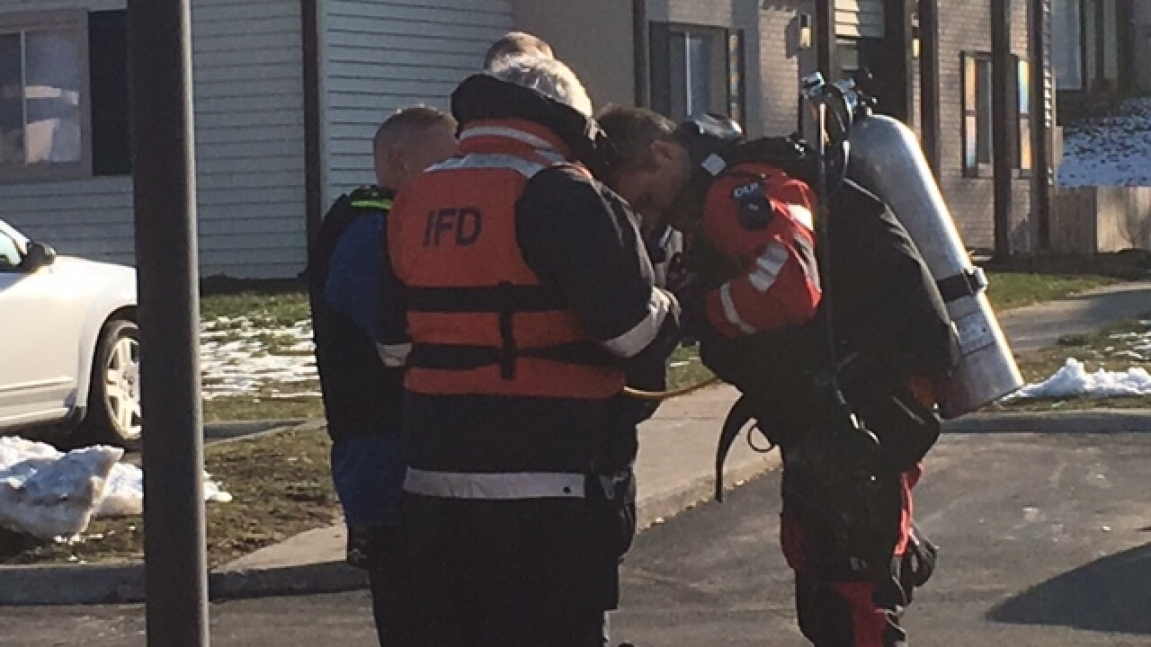 Father, child rescued from pond on Indy's N side