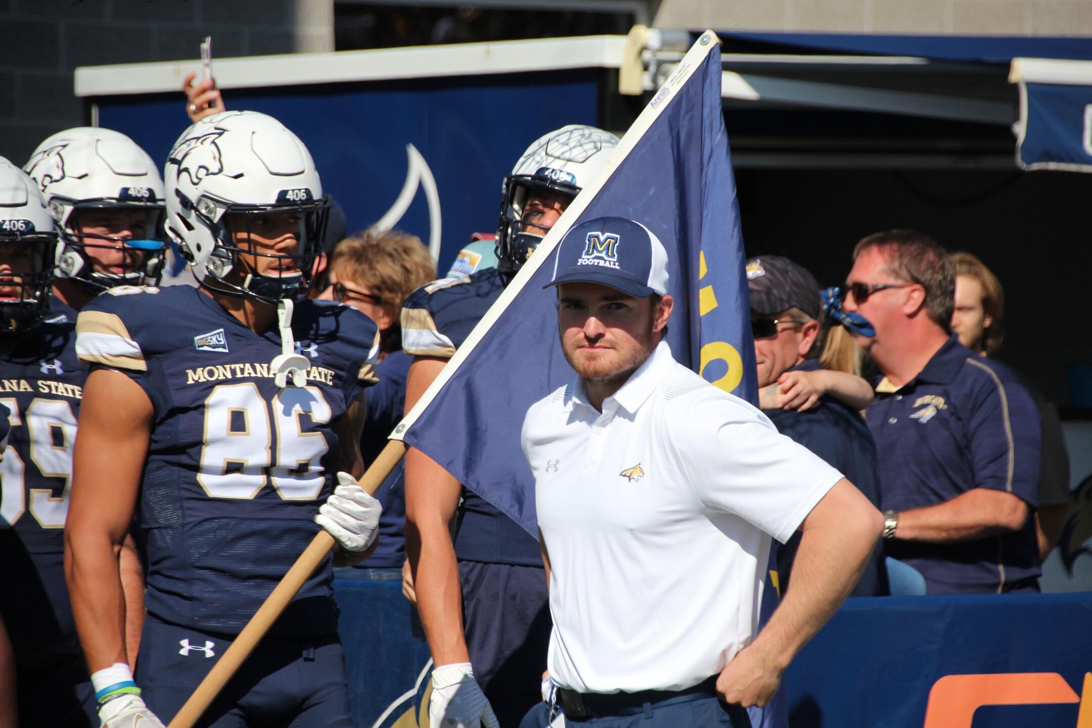 Lance McCutcheon carries the state flag