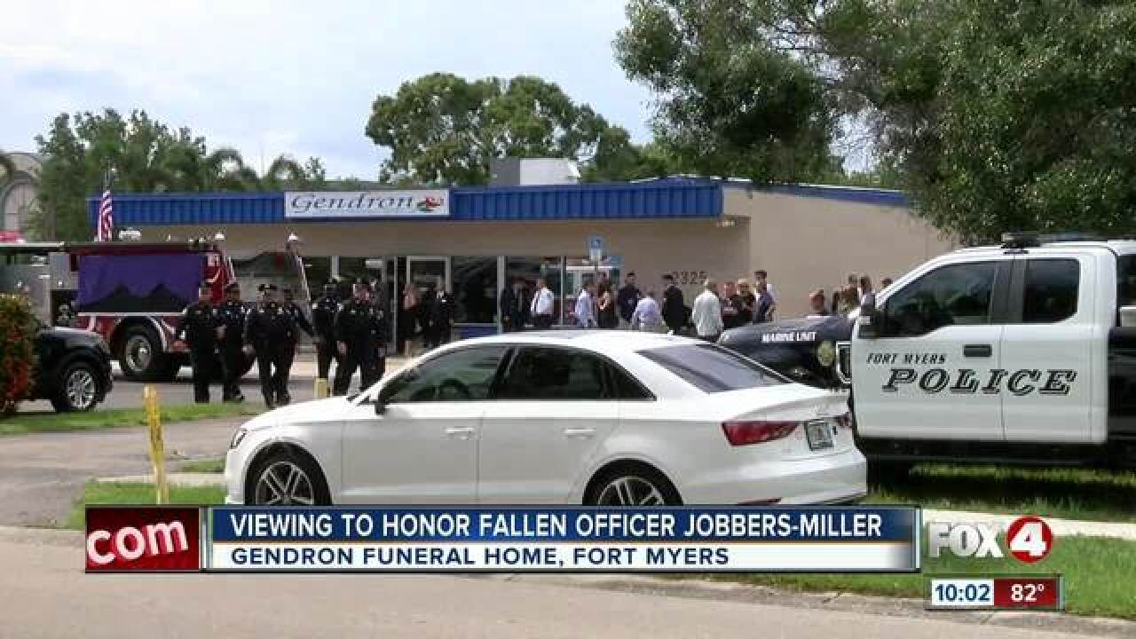 Hundreds pay respects to fallen officer
