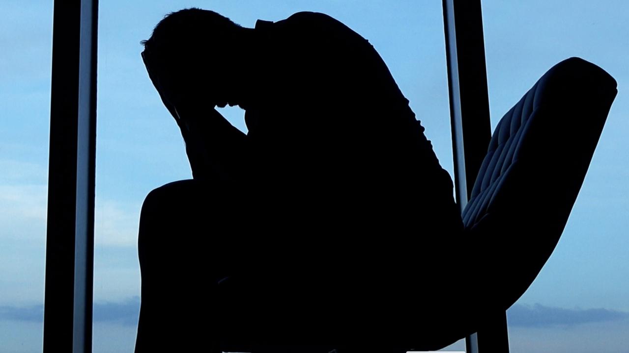 Man sitting in chair depressed
