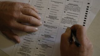 Federal judge lets voters fix ballot signature