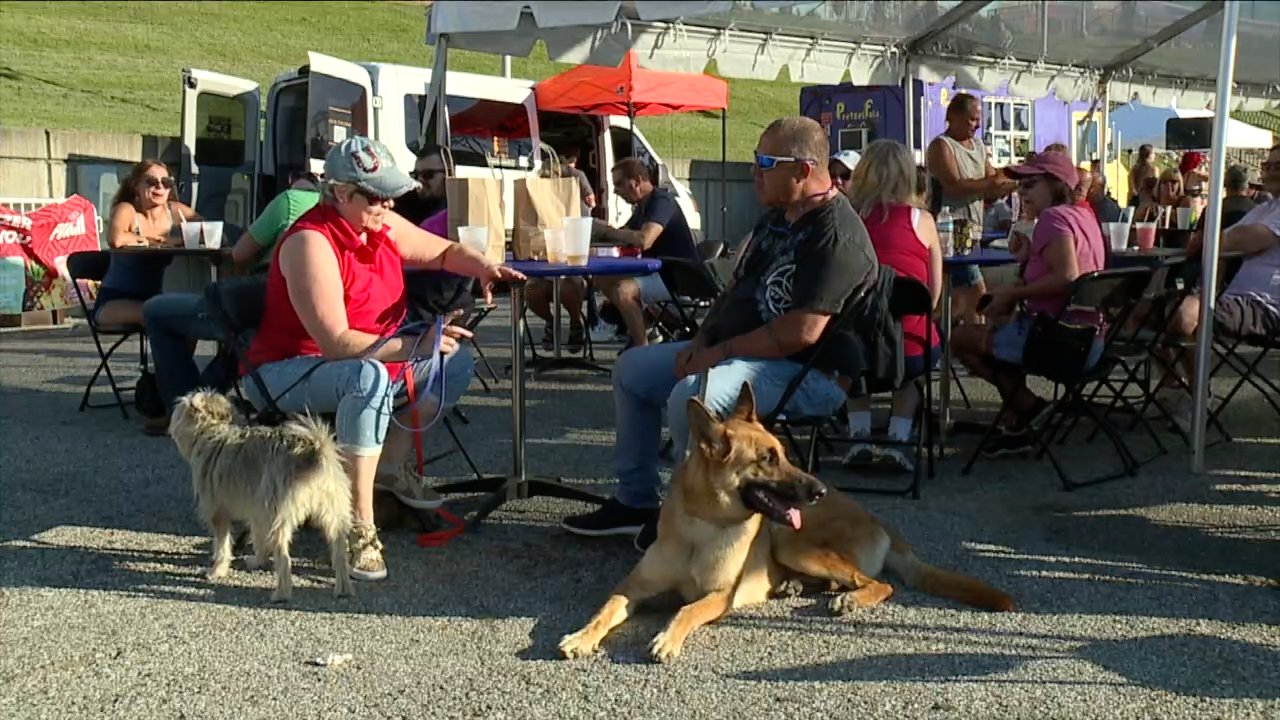 People and pooches enjoy Dog Night at the Party on the Purple.png