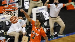 Miami Hurricanes guard Isaiah Wong dunks against Pittsburgh Panthers during 2021 ACC Tournament