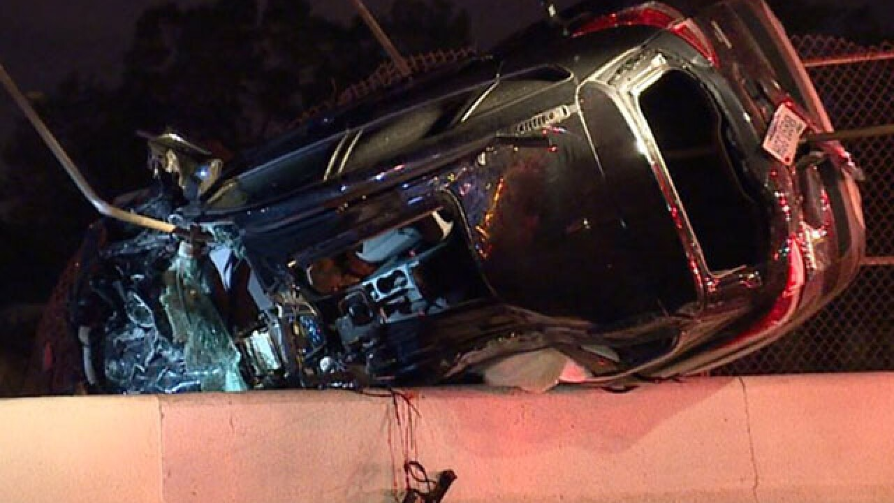 Driver rescued from SUV dangling from bridge