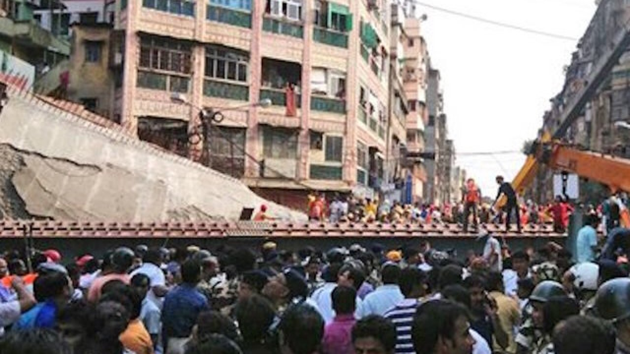 India overpass collapses kills 1, traps others