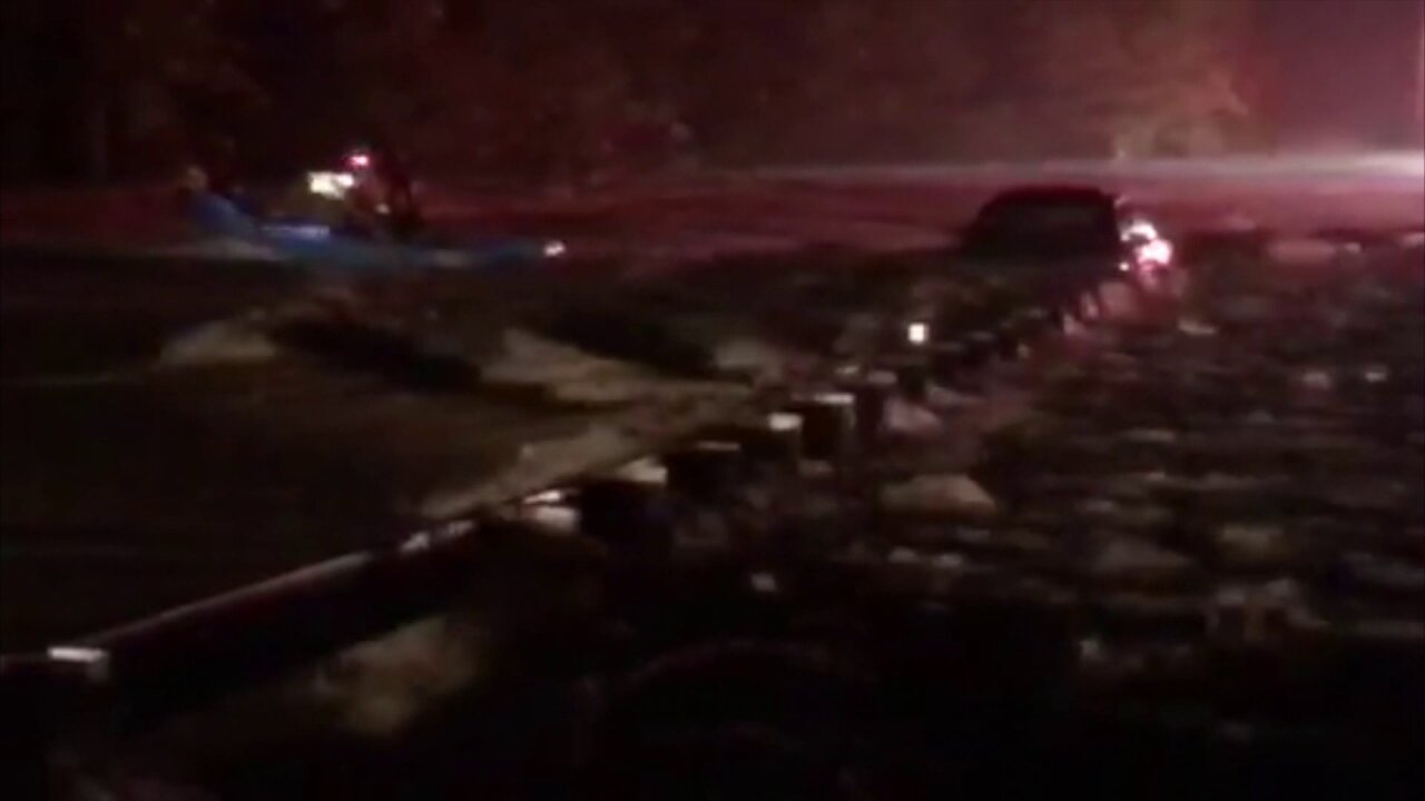 Driver trapped in flood water on Otterdale Road rescued bycanoe