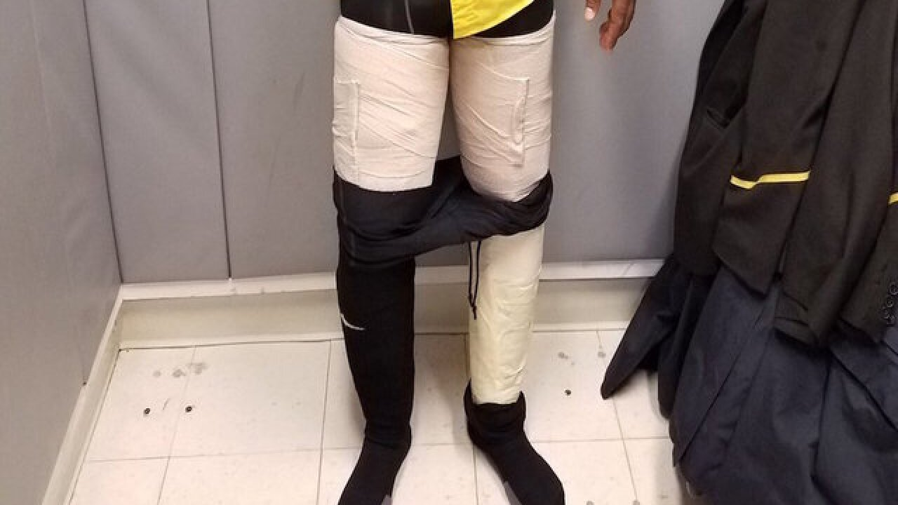 Airline worker busted with 9 pounds of cocaine taped to legs