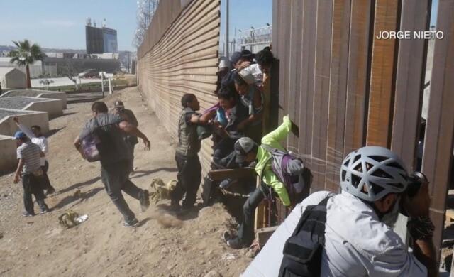 Clashes erupt as migrant caravan reaches the U.S.-Mexico border