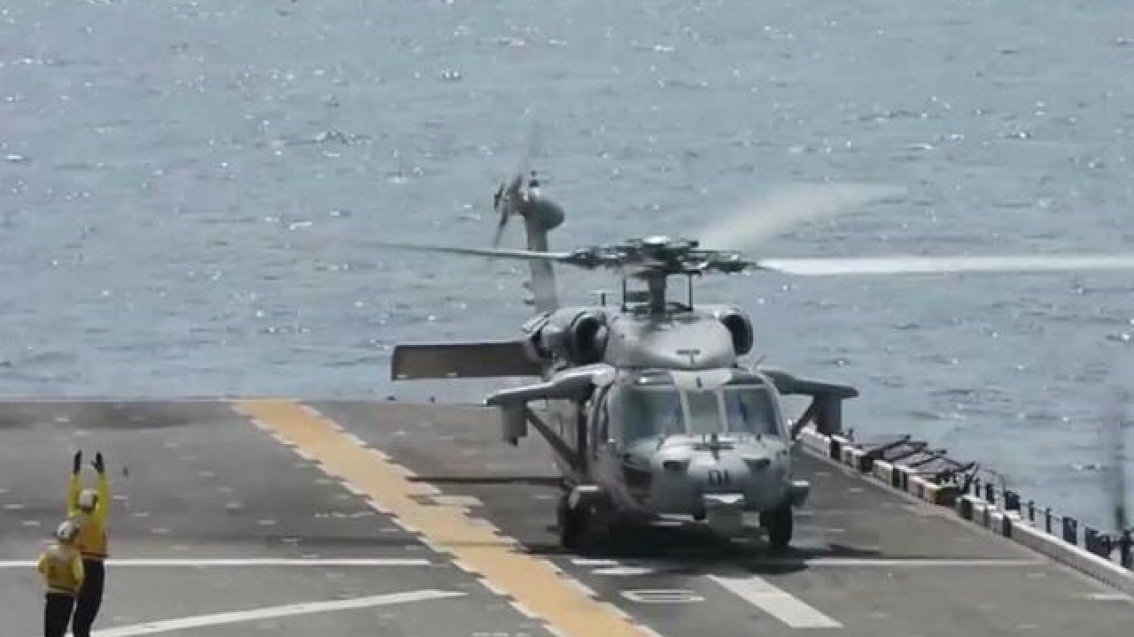 Families of men killed in helo crash suing Navy
