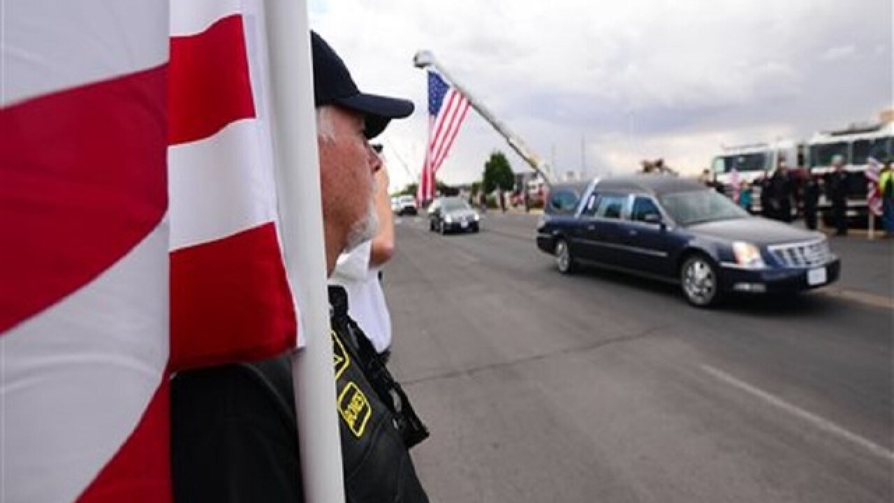 Thousands honor slain New Mexico police officer at funeral
