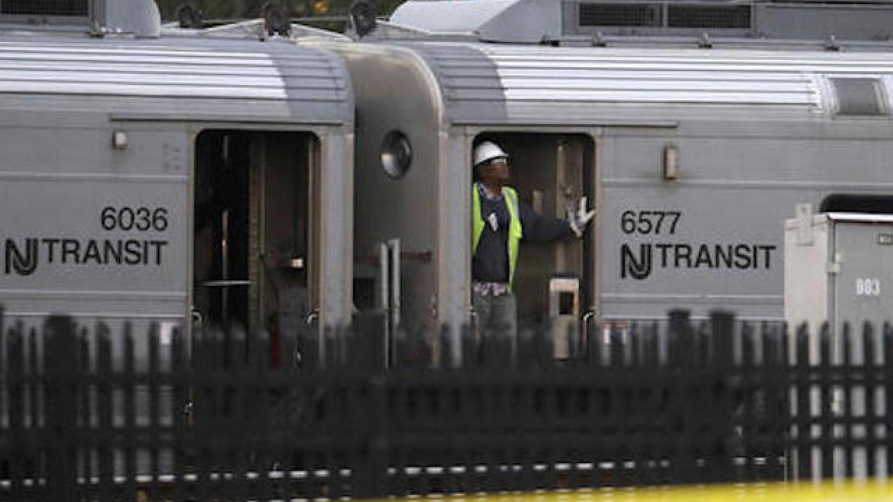 Damaged NJ Transit train removed from terminal after crash
