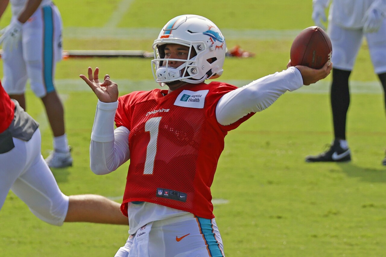 Miami Dolphins QB Tua Tagovailoa throws football during training camp, Aug. 17, 2020