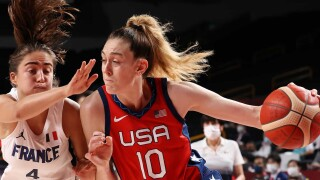 USA wins 52nd straight, but France survives in women's hoops