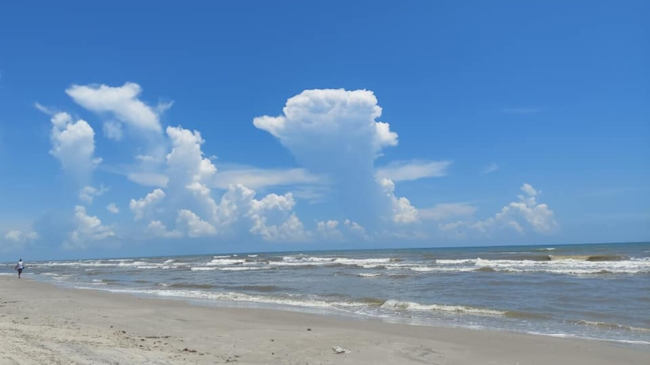 Gulf showers seen from Bob Hall Pier - Photo By: FB Coastal Bend Weather Watcher Cal Adele
