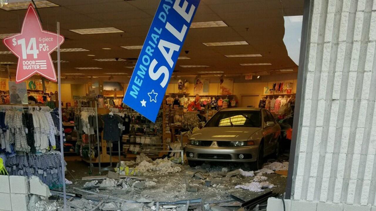 Car backs into Farmington Hills' Carter's store