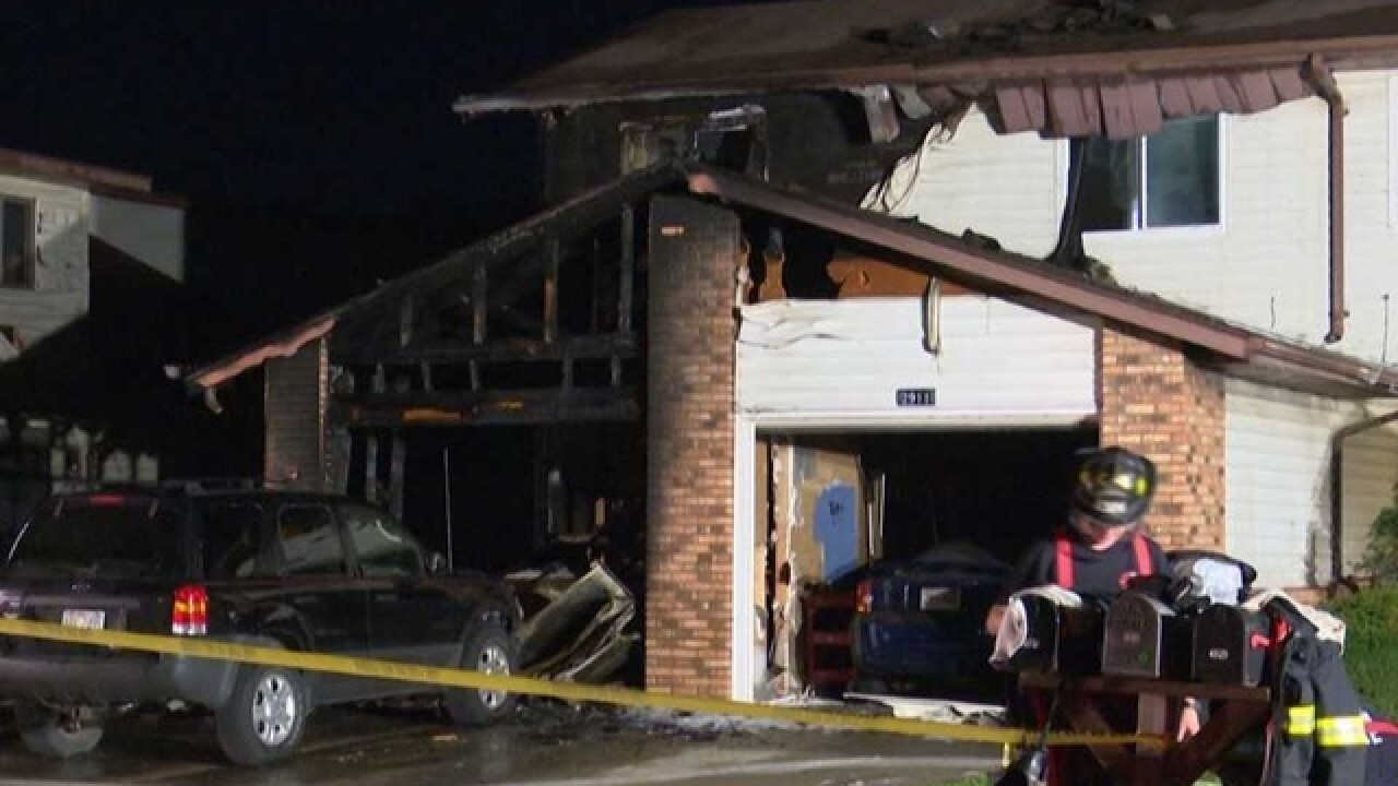 Firefighter treated for exertion after garage fire spreads to apartment