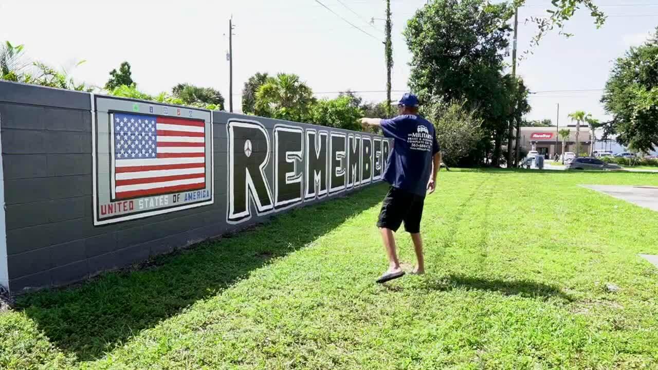 Matt Verlander points at 9/11 wall mural